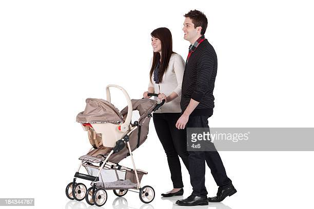 couple with a pram - pushchair stock pictures, royalty-free photos & images
