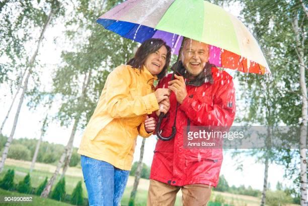 Couple with a rainbow umbrella. Debica, Poland