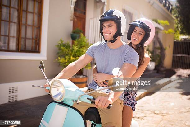 Couple with a scooter on a road trip vacation