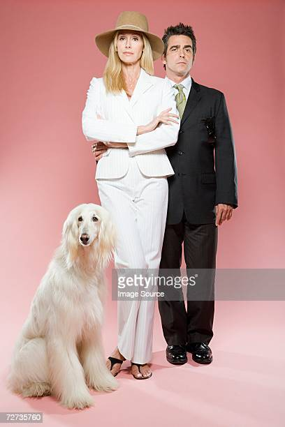 Couple with an afghan hound
