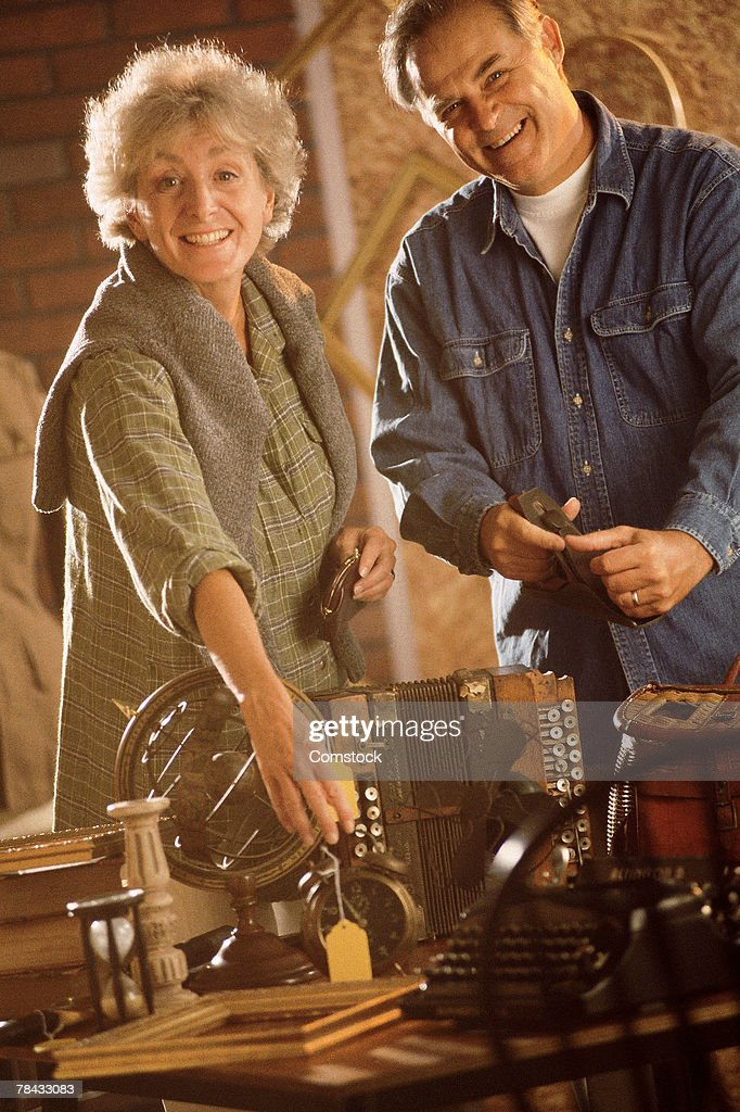 Couple with antiques : Stockfoto