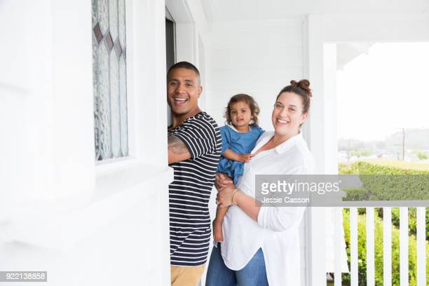 Couple with baby enter their new home