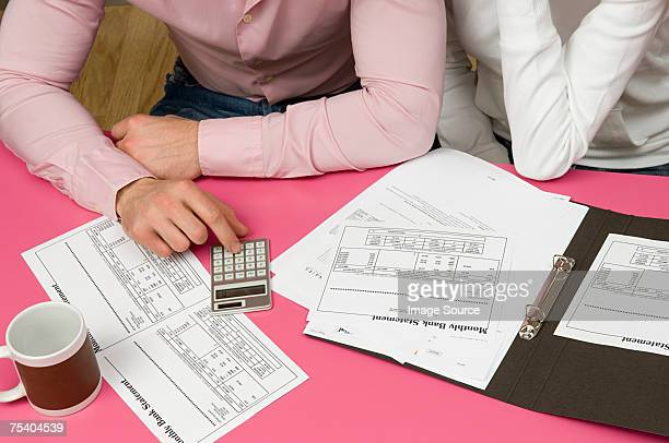 Couple with bank statements