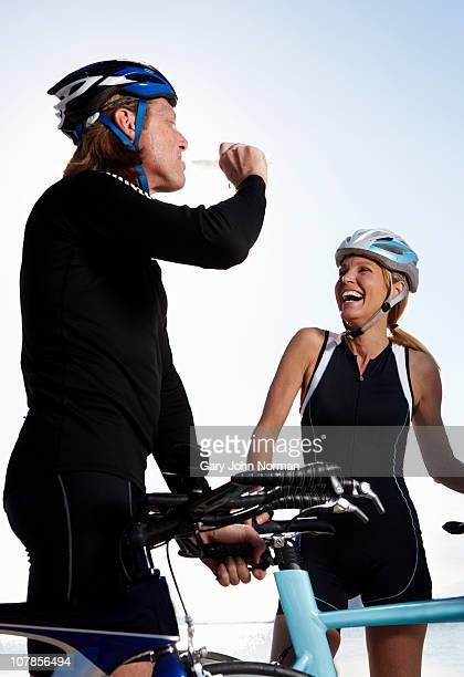Couple with bicycle relax before training