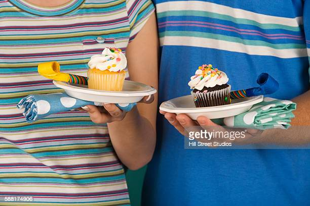 Couple with Birthday Cupcakes