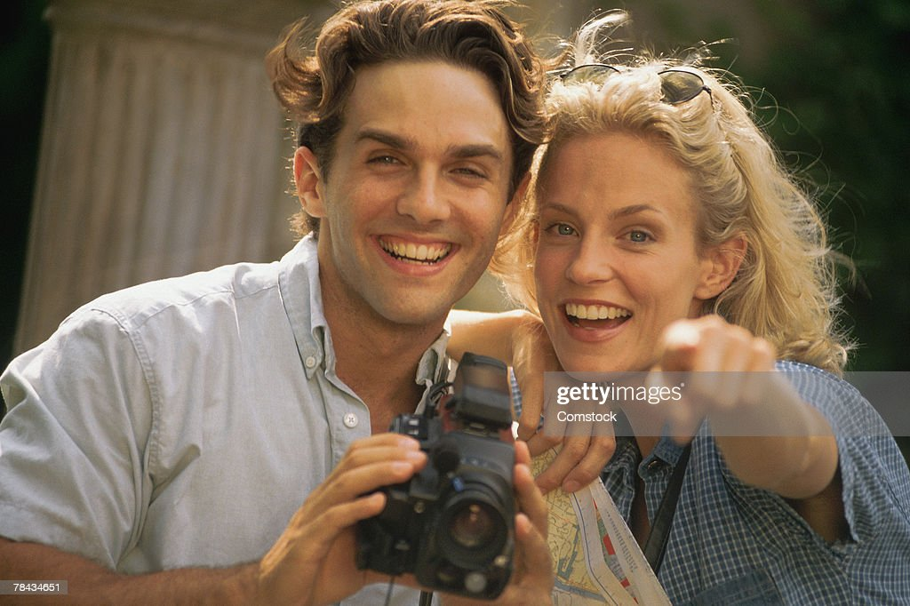 Couple with camcorder on vacation : Stockfoto
