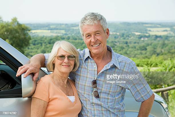 Couple with car in the countryside