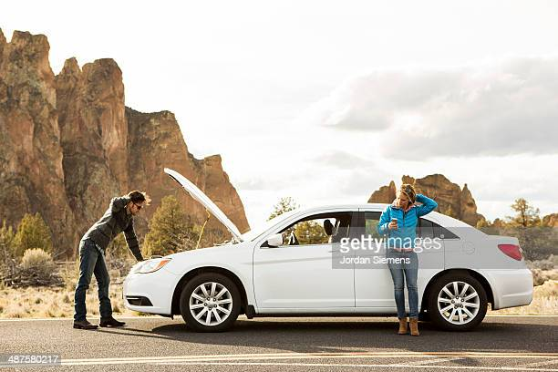 A couple with car trouble.