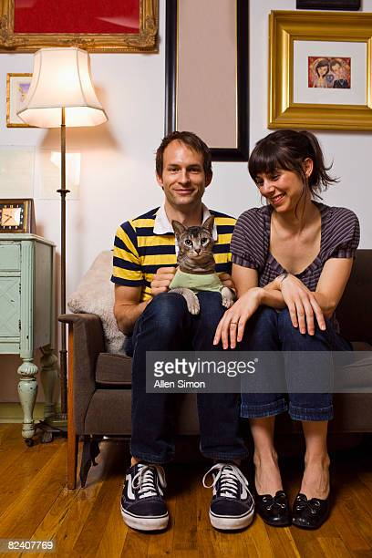 Couple with cat in small apartment
