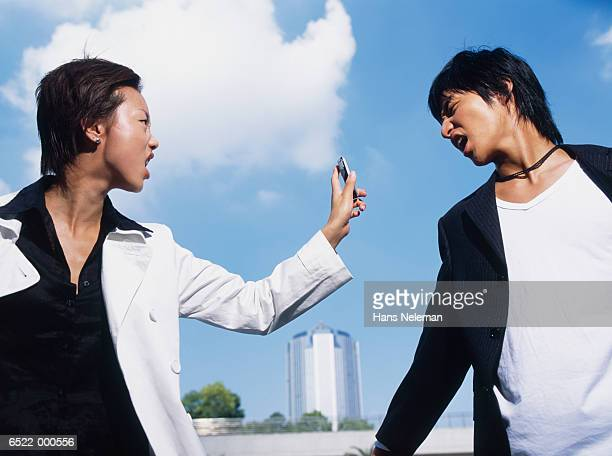 Couple with Cell Phone Arguing