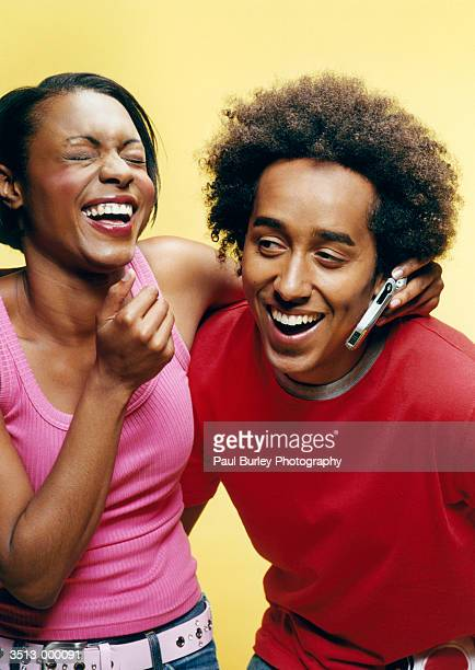 Couple with Cellphone Laughing