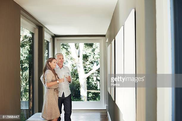 couple with champagne flutes looking at pictures - admiration stock pictures, royalty-free photos & images