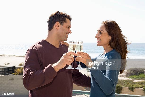 couple with champagne - heterosexual couple stock pictures, royalty-free photos & images