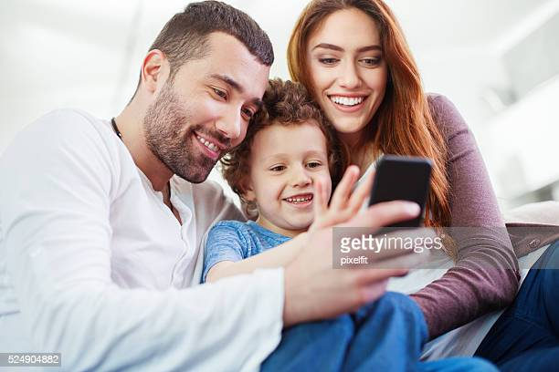 Couple with child and smart phone