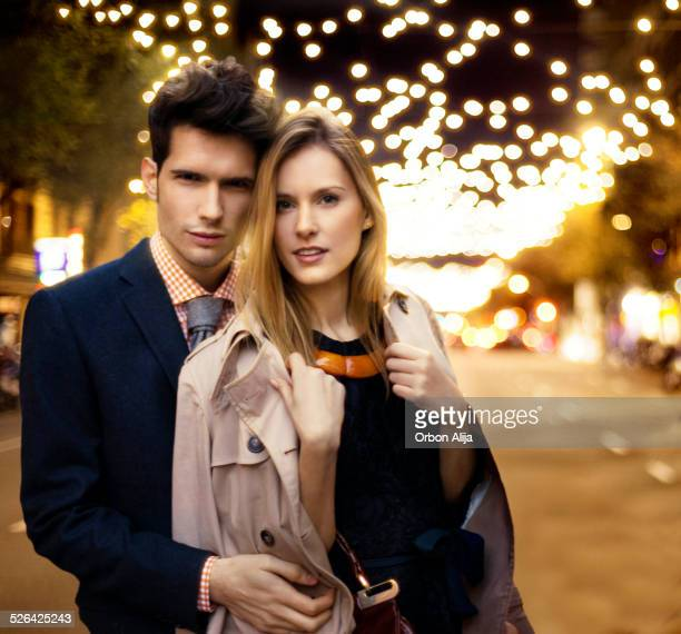 Couple with Christmas lights