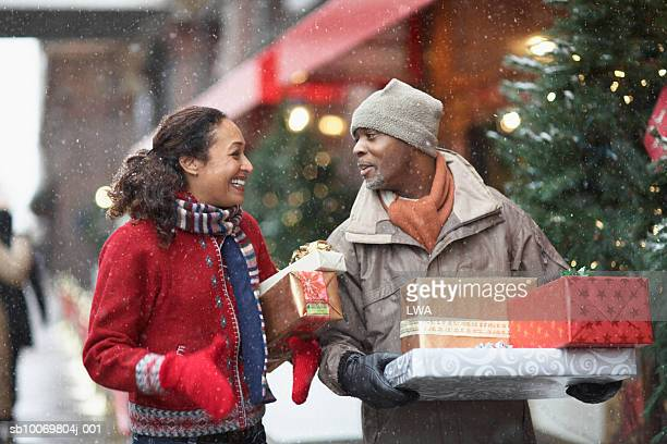 Couple with Christmas presents on street