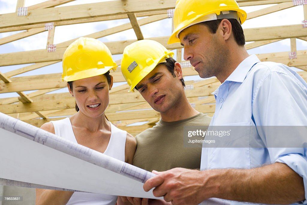 Couple with contractor : Stock Photo