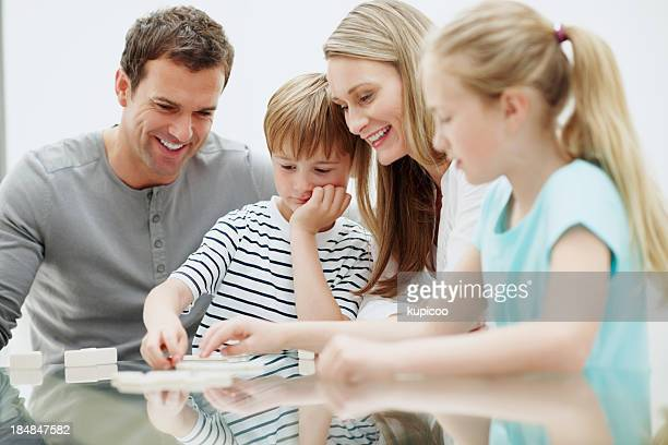 Couple with cute kids playing games