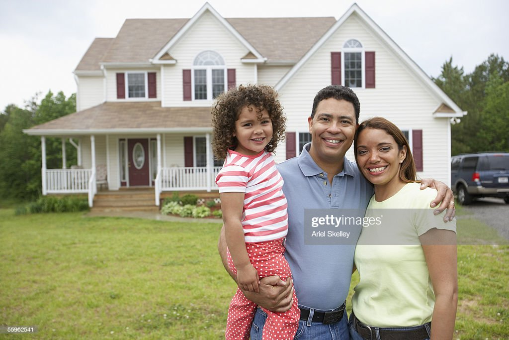 Couple with daughter together in front yard : Stock Photo