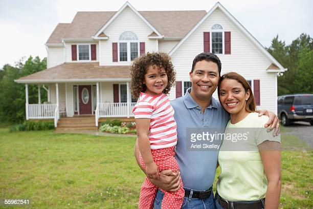 couple with daughter together in front yard - middle class stock pictures, royalty-free photos & images