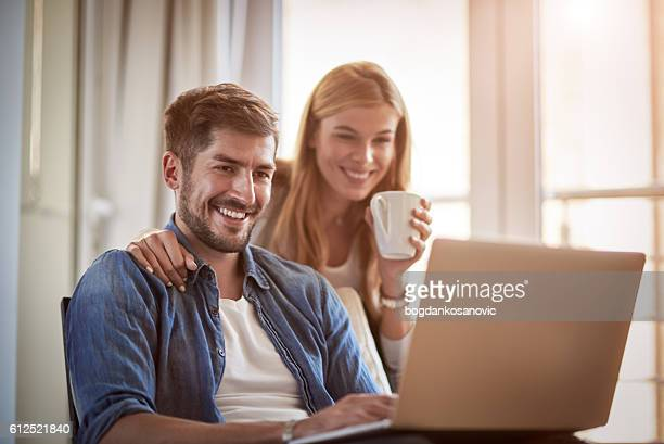 Couple with digital laptop