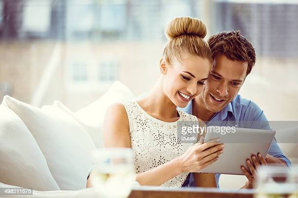 Couple with digital tablet