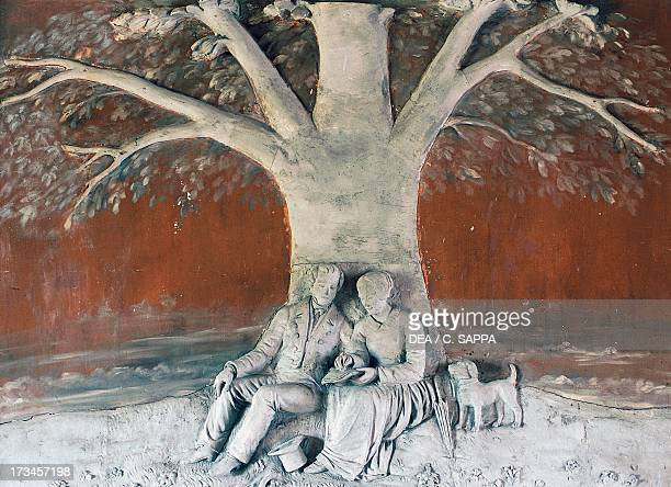 Couple with dog sculptural decoration Najac Castle MidiPyrenees France
