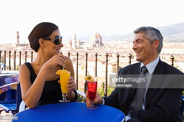 Couple with drinks, Florence, Italy