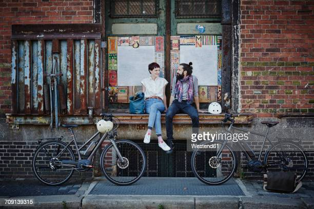 couple with electric bicycles - hamburg germany stock pictures, royalty-free photos & images