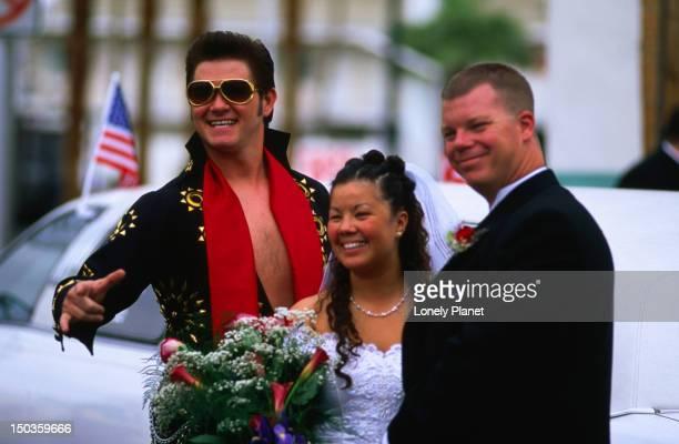 Couple with Elvis impersonator at Viva Las Vegas Wedding Chapel.