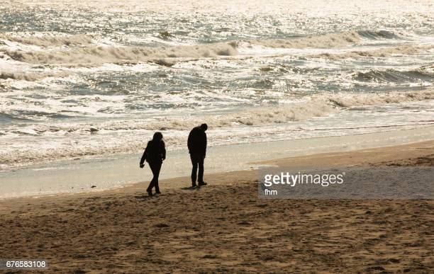 A couple with emotional stress on the beach