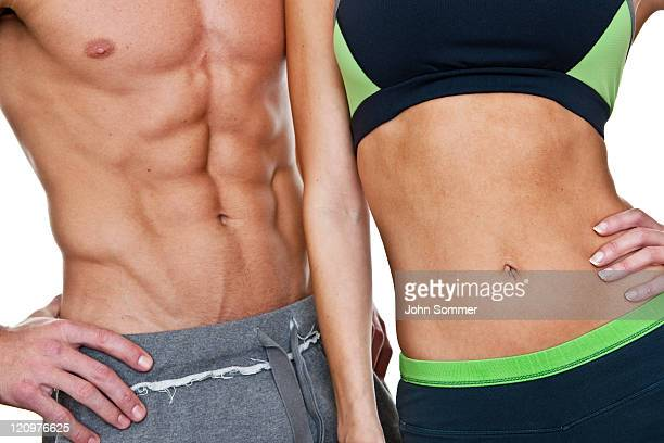 couple with fit abs - torso stock pictures, royalty-free photos & images