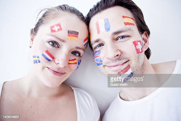 Couple with flag paintings