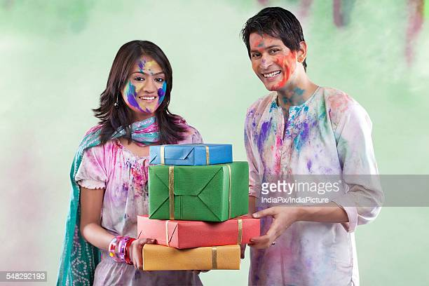 couple with gifts on holi - new generation stock pictures, royalty-free photos & images