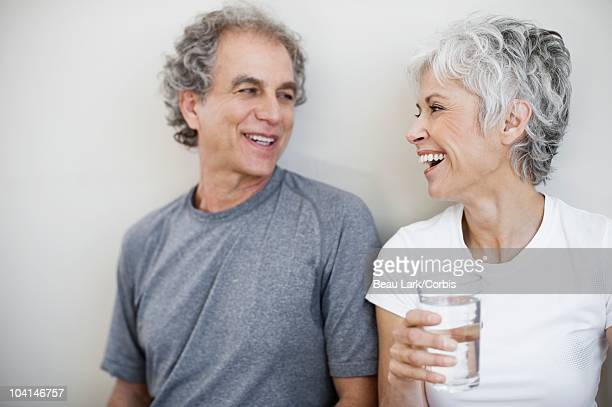 Couple with glass of water