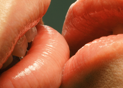 Couple with glossy lips kissing, close-up - gettyimageskorea