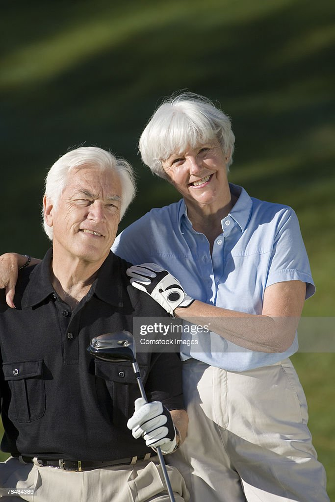 Couple with golf club : Stockfoto