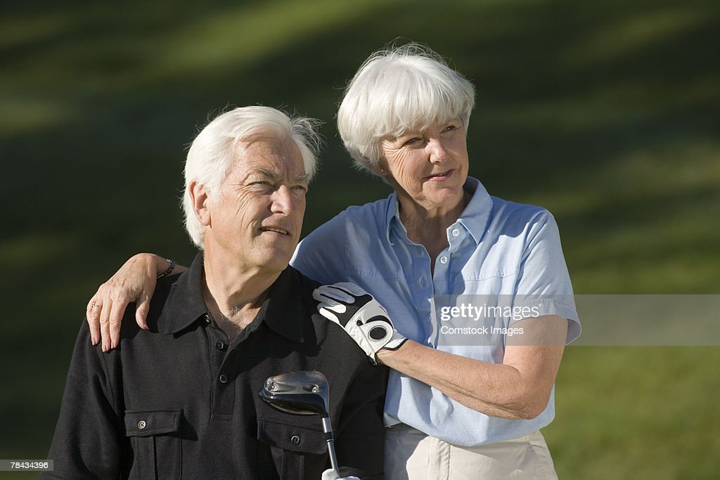 Couple with golf club : Stockfoto