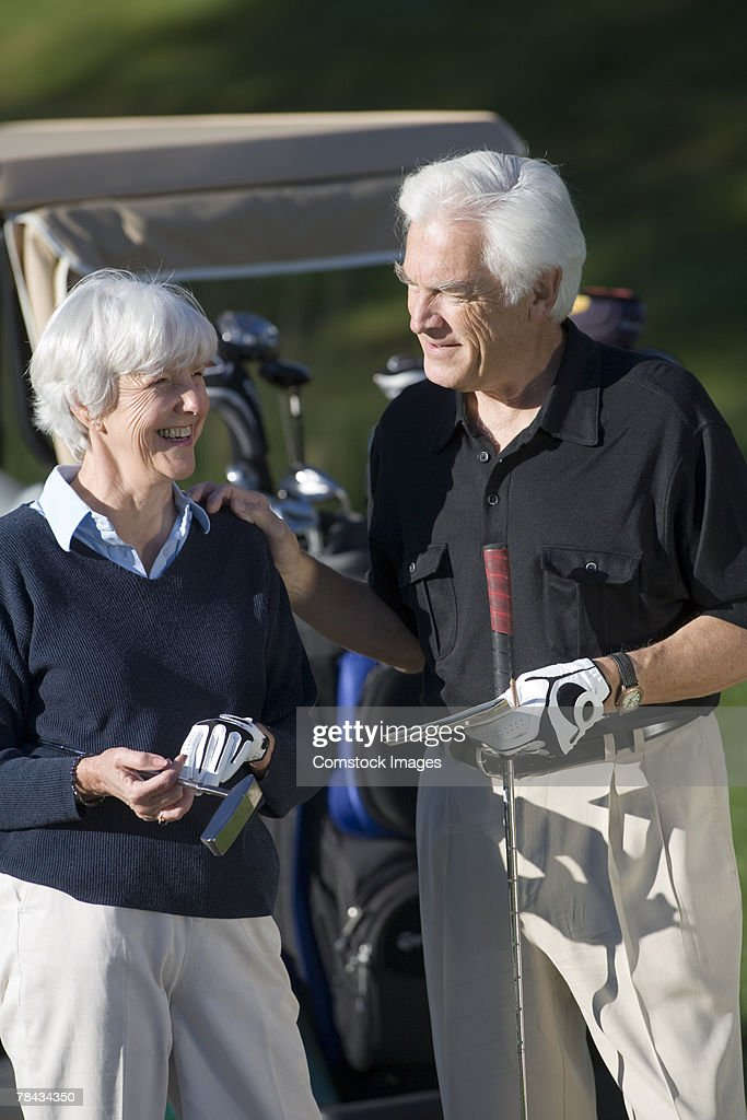 Couple with golf clubs : Stockfoto