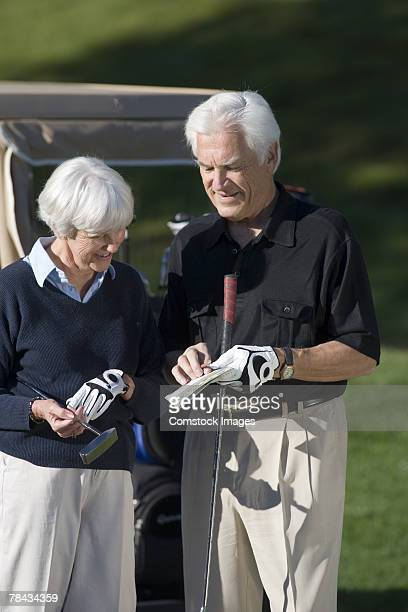 Couple with golf clubs