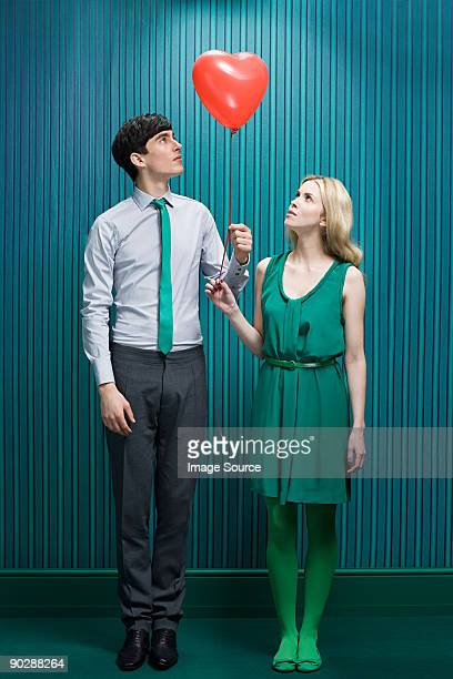 Couple with heart shape balloon