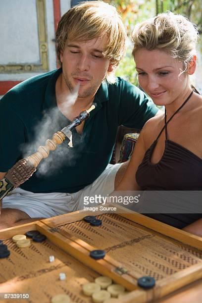 couple with hookah and backgammon - 水キセル ストックフォトと画像