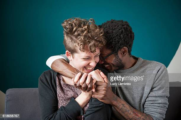 couple with intertwined hands laughing playfully - flirting stock pictures, royalty-free photos & images