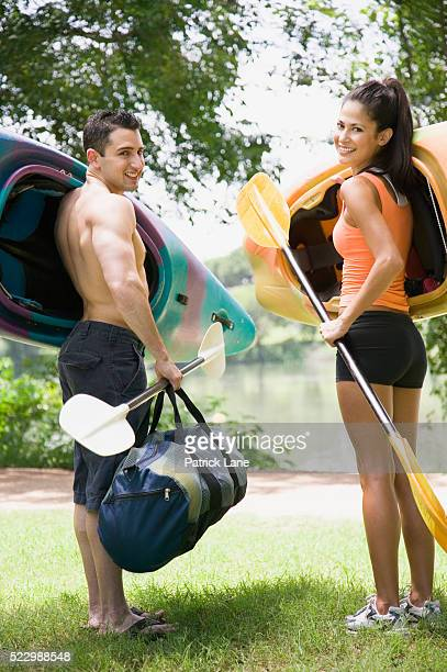 Couple with kayaking gear