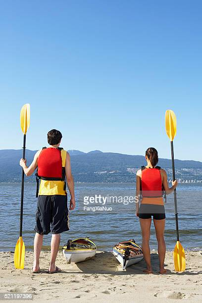 Couple with kayaks