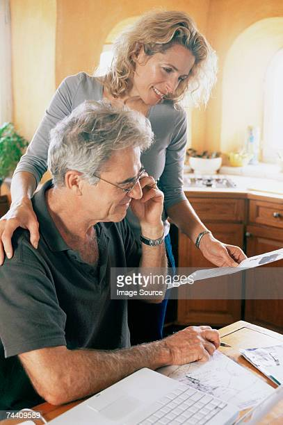 Couple with laptop and paperwork