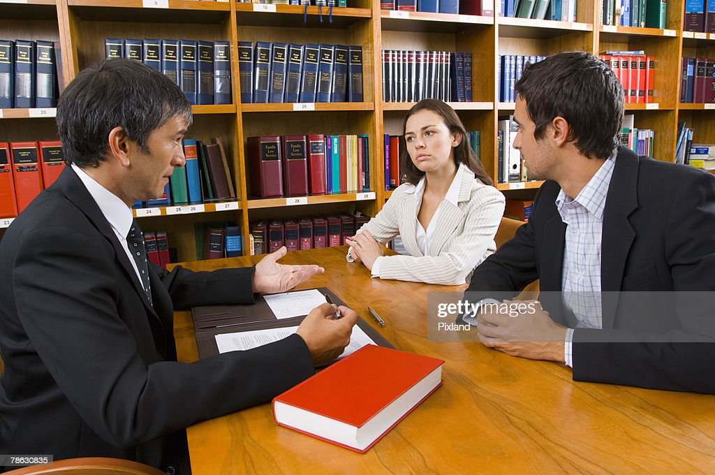Couple with lawyer : Stock Photo