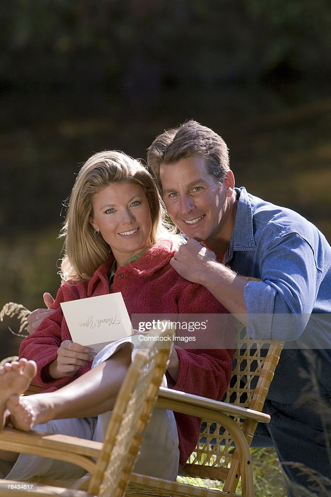 Couple with letter outdoors : Stockfoto