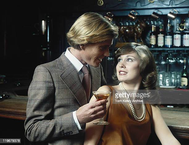 Couple with liqueur glass at bar