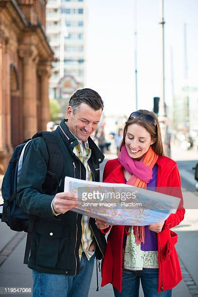 Couple with map sightseeing in city